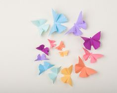 3D Wall Butterflies: Butterfly Wall Art for Nursery, Girl's Room, or Home Decor - Set of 20 in Pastel Rainbow. $38.00, via Etsy.