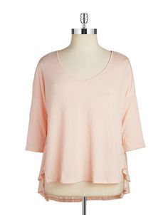 "<ul> <li>A textured hem adds movement to this simple blouse</li> <li>V-neck</li> <li>Three-quarter dolman sleeves</li> <li>Asymmetrical hi-lo hem</li> <li>About 30"" from shoulder to hem</li> <li>Polyester/elastane</li> <li>Machine wash</li> <li>Imported</li> </ul>"