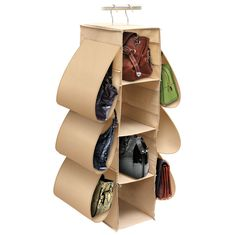 Stop putting your handbags on the floor of your closet or letting them collect dust on a shelf! This hanging handbag storage organizer features two metal hooks that easily hang from any closet rod to keep your stylish bags dust-free and off the floor. With four center compartments and six side compartments, your large and small purses will have a fantastic new home.