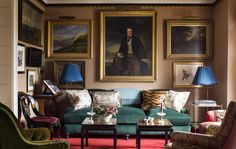 In the drawing room of his own Manhattan apartment, the decorator presented an assemblage of gilt-framed pictures hung salon-style, edging the ceiling with gold fillet.