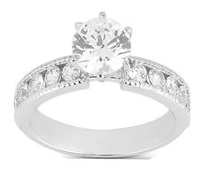 Make her shower you with compliments with this beautiful Engagement Ring. Prong set with 0.80CTW Round and Brilliant cut diamonds. Set in the center is 0.30 CTW round Cut Diamond all the diamonds are meticulously set in this beautiful ring, which carries milgrain edges... Made with 14K white gold. A great value that is worth buying!!!