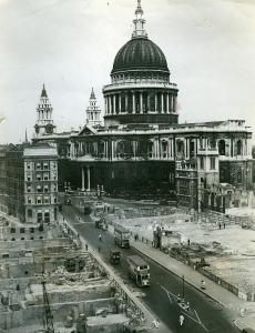 London buses operate in the midst of air raid devastation, St Paul's Cathedral, August 1942