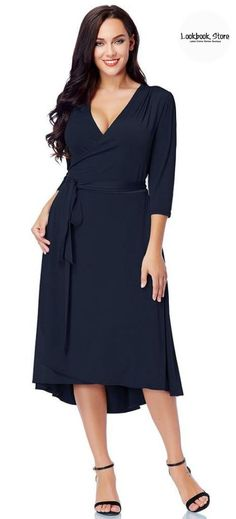 It's time to give in to another classic dress like this plus size navy high-low wrap skater dress.