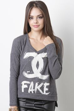 Be apart of the latest trend in this Fake CC Sweater Top. This top features a lightweight soft material, round neckline, long sleeves, asymmetrical hemline, and a contrasting fake CC printed front.