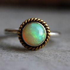 My new creation dual tone ring, 18k gold and silver Opal artisan Ring. Beautiful, mesmerizing, finest Ethiopian opal ring. Natural opal gemstone is bezel set in sterling silver with 18k solid gold rope design, an artisan jewelry. Also, opal is October birthstone.