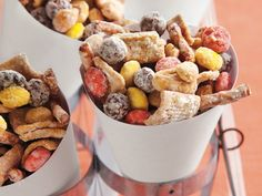 4c Golden Grahams  2c Cocoa Puffs  2c thin pretzel sticks (2 1/4 inch)  1c candy-coated peanut butter candies  1c dry-roasted peanuts  10oz white chocolate baking bars or squares, chopped  2T butter or margarine  1/2c powdered sugar