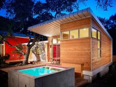 A stained cedar theme with a lively color palette transforms this remodeled home in Austin, Texas into a work of art further enhanced by a private backyard deck with a showstopping plunge pool of concrete and tile.