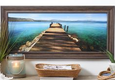 Whose interests don't include long walks by the ocean? Bring your favorite beach destination into your home with our Hues of Blue Framed Art Print! This gorgeous color photo of a dock on a sunny day is a great escape from your everyday life and a great addition to your wall decor.