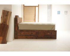 """This bed is designed for a range of storage. As pictured, the bed boasts four cavernous 26"""" deep drawers to fully maximize the space in your sleeping headquarters. Reclaimed Old growth Douglas Fir. This platform bed is designed to hold a queen mattress around the perimeter. It can be made for any size bed and any of the dimensions can be customized, just ask. The pictured bed is Eastern King, with a Queen, the platform cabinets will be nearly touching, eliminating the need for slats between…"""