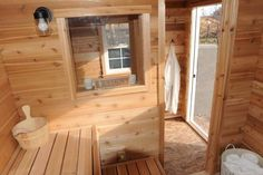 """Cedar tongue and groove is used throughout this sauna. The """"candle window"""" is an extra feature that Glenn Auerbach, an outdoor sauna builder who operates SaunaTimes.com, says can create a feeling of openness in an outdoor sauna."""