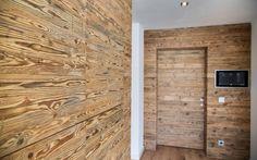Wandverkleidung aus Altholz mit Smart Home Steuerung