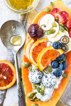 Papaya Breakfast Boats ~ breakfast just got a whole lot more interesting, with gorgeous tropical papaya filled to the brim with non dairy yogurt and colorful fresh fruit. #breakfastbowl #papaya #healthy #yogurt #glutenfree #whole30 #protein #brunch #fruit #recipe #benefits #smoothie #smoothiebowl