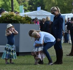 Lady Louise Windsor gives her tiny cousin Isla Phillips a big hug, watched by her mother S...