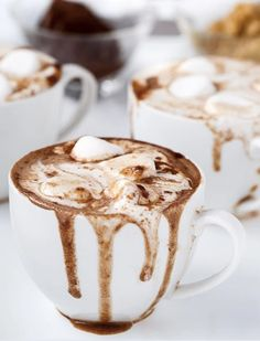 PEANUT BUTTER NUTELLA HOT CHOCOLATE - 17 Hot Cocoa Recipes That Will Get You Through Winter via @PureWow