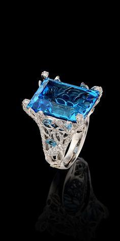 Master Exclusive Ring 7050.  Collection: Solo - 18K white gold, topaz 29,80 ct, diamonds, topaz.