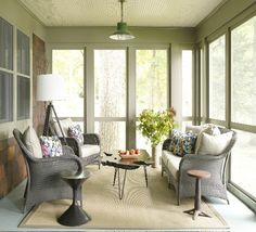 sage green walls and grey wicker chat set on the screened in porch - I like barn light electric used as the lighting fixture