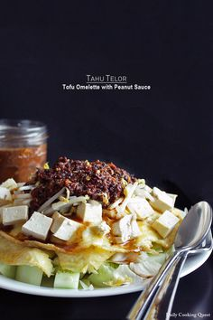 Tofu Omelette with Peanut Sauce. Indonesian tofu omelette with cucumber cabbage bean sprouts and peanut sauce Indonesian Cuisine, Indonesian Recipes, Savory Snacks, Savoury Dishes, Vegetable Dishes, Vegetable Recipes, Veggie Food, Tofu Omelette, Tofu Recipes