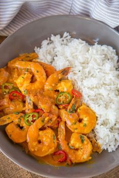 Indian Shrimp Curry made with coconut milk, tomato sauce and warm Indian spices is a quick 20 minute curry dish you can enjoy any day of the week!
