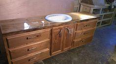 Rustic bathroom vanity with a liquid glass top