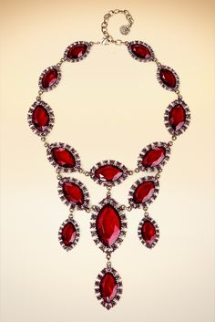 Faceted ruby-red stone teardrops link to create a captivating statement piece that will be worn beyond the holiday season.