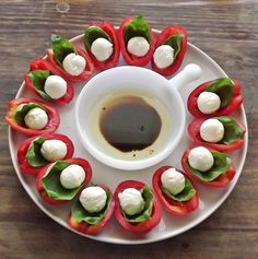 Scooped out plum tomatoes with basil and bocconcini. Sprinkle with salt and balsamic vinegar.