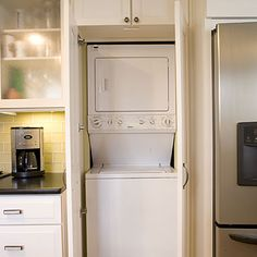 Disguised behind what looks like a kitchen pantry, this compact washer and dryer fits snugly into a nook in the kitchen. Cabinets above the washer and dryer can be used to organize detergent, dryer sheets, and other laundry essentials. Laundry Closet Organization, Laundry Room Organization, Laundry Storage, Organizing, Laundry In Kitchen, Small Laundry, Kitchen Pantry, Kitchen Cabinets, Laundry Rooms