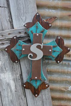 Initial western wooden wall cross by SparkleySpur on Etsy, $49.00  I saw the turquoise, & the S, & the western design & thought of my big sis.....  ;)