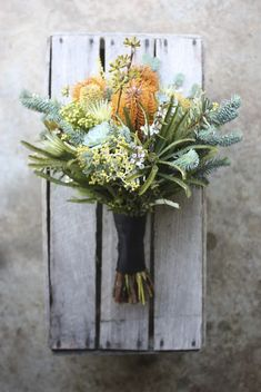 Romantic hues and modern textures feature in this stunning bridal bouquet in soft pinks and greens…. Protea, Brunia, Eucalyptus, Seeded Gum and Leucadendron Image Source – Swallows Nes… Winter Flowers, Seasonal Flowers, Colorful Flowers, Wild Flowers, Blue Spruce, Green Wedding, Floral Wedding, Boutonniere, Australian Native Flowers