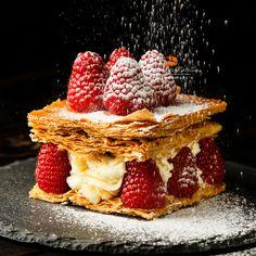 мильфей - Millefeuille dessert with raspberry on black background