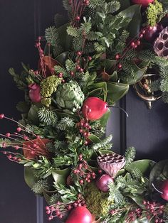 """Emily A. Clark's """"A Little Christmas Prep + A Big Gift Guide"""" features the Colonial Magnolia Wreath on her front door."""