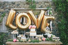 What's more fun than letter balloons? Spell out your and your groom's initials, or declare your affection for each other like this cake display does.