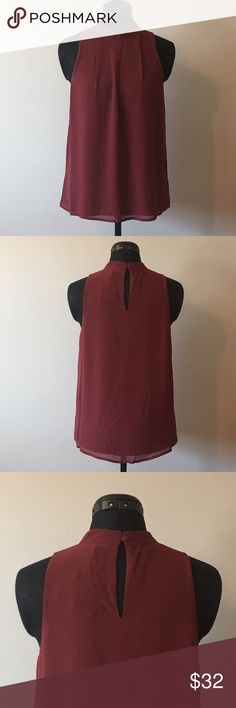 Wine Sleeveless Blouse Beautiful wine blouse that would be great for a Valentine's outfit. You could also wear to work. This blouse is sleeveless and doubled lined. The neckline is higher for a more conservative look.    Fabric: Woven Material: 100% Polyester   Modeling a Small   Measurements: Small: Length- 24in   Bust- 34in Medium: Length- 25in  Bust- 36in Large: Length- 26in  Bust- 38in chiccouture Tops Blouses
