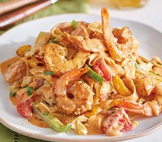This recipe for Cajun Prawn Pasta features plump jumbo shrimp seasoned with southern spices, tossed with crisp-tender peppers and onions, with wine, garlic and Parmesan, served over fresh fettuccine. A wonderful way to warm up on a cold night! Greek Recipes, Veggie Recipes, Fish Recipes, Seafood Recipes, Vegetarian Recipes, Dinner Recipes, Cooking Recipes, Prawn Pasta, Appetisers