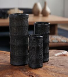 Haitian artisans are reinterpreting the art of papier-mache to create these sophisticated column vases out of tobacco leaves on the inside and durable leather and burlap on the outside. Make this timeless collection, part of the D.O.T initiative, a pillar of your home decor. Ten percent of net proceeds from D.O.T products is donated to the Urban Zen Foundation.
