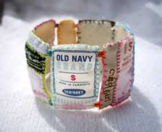 After decades of tucking and retucking our damn shirt tags in, some smarty-smart designs this cute cuff to HIGHLIGHT the tags.  Genius!
