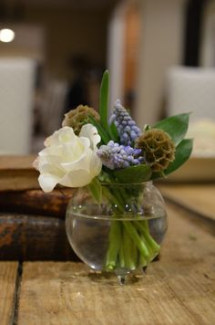sweet little arrangement of blue muscari and white rose...perfect for tables at a cocktail hour