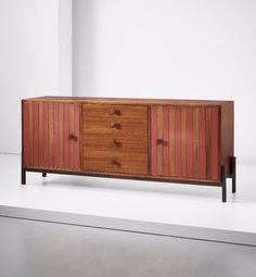 Ettore Sottsass; Rosewood, Lacquered Wood and Bronze Sideboard for Poltronova, c1959.