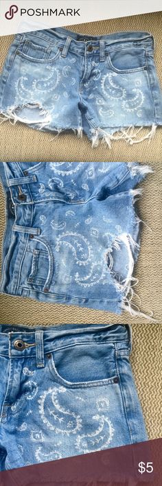 Lucky Brand Cut Off Shorts Very small size 0 and/or 25 Cut Off Skimpy Lucky Brand Denim Shorts made to look ripped and frayed, southwestern paisley design zip with button front , pockets in front and back, I did not wear these many times but when I did it was Horseback Riding and four-wheeling and so they have slightly noticeable light mud stains around the butt pockets (see pic) which can probably be removed, priced super low because of that but they have a lot of life left and hate to see…