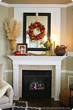 fall mantel decorating...I love the wreath hanging on the mirror