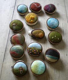 "Lisa Jordan  new brooches    ""A handful of little brooches that I've been working on. I'm really loving this concept and am eager to keep tweaking it.    I've made wool felt by hand, sometimes embroidering it, and each little fiber piece is fitted into a ring of birch bark. I then cover the back and add a pinback."""