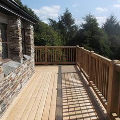 An oak frame balcony by Carpenter Oak Cornwall with Siberian larch decking boards. Post And Beam, Stair Treads, Decking Boards, Decking Ideas, Windmill, Cornwall, Beams, Balcony, Home Improvement