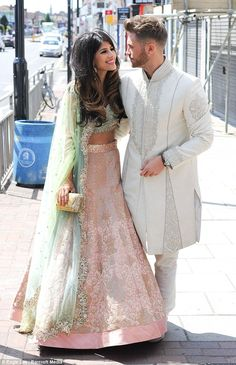 Fingers crossed: The beauty - dressed in full Indian wedding garb for the series, which focuses on British Asians - hopes she won't be hit by the reality TV couple 'curse'