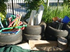 Sandpit Storage - using tyres. Works great, no more lugging things to the shed.