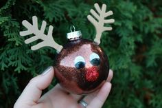 Make your own #DIY Rudolph ornament! All you need are clear glass ornaments, glitter, floor wax, and Elmer's Painters and glue to decorate! #christmascrafts #DIYornaments