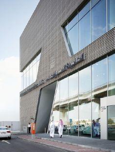 Audi Terminal - Dubai - Metal Facade - hexagonal perforation & folded aluminium panels