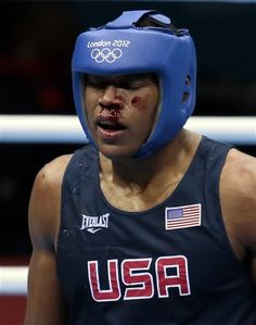 Michael Hunter II, of the United States, is seen with a bloody face during his bout against Russia's Artur Beterbiev during their men's bantam 56-kg boxing match at the 2012 Summer Olympics, Wednesday, Aug. 1, 2012, in London. (AP Photo/Ivan Sekretarev)