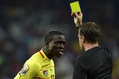 SOUTH AFRICA, Nelspruit : Togo's forward Jonathan Ayite (L) reacts after being handed a yellow card by a referee during the Africa Cup of Nations 2013 Group D football match between Tunisia and Togo at Mbombela Stadium in Nelspruit, on January 30, 2013. AFP PHOTO / FRANCISCO LEONG