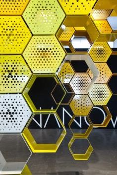 Buy the Shelf Honey-Way from Officina Nove, on Made in Design - 48 to 72 hours delivery. Stand Design, Display Design, Booth Design, Wall Design, Environmental Graphics, Environmental Design, Motif Hexagonal, Hexagon Pattern, Exhibition Display