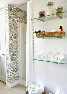 DIY bathroom renovation on a budget. How to turn a dark bath into a bright… DIY bathroom renovation on a budget. How to turn a dark bath into a bright modern space, new diy closet, shower, diy glass tiling & custom treatments. Glass Shelves In Bathroom, Floating Glass Shelves, Bathroom Wall, Small Bathroom, Master Bathroom, Downstairs Bathroom, Glass Shelf Brackets, Mounting Brackets, Budget Bathroom