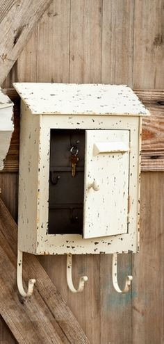 """Cream Distressed Mailbox With Key Hooks-Mail. Paperwork. Catalogs. Magazines. Indoor. Outdoor. Whatever the use.....wherever the display, our farmhouse mailbox collection will knock your socks off.Cream Farmhouse Mailbox measures12"""" x 5"""" x 19"""""""